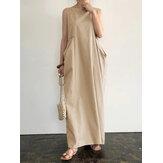Damska elegancka jednokolorowa sukienka z bocznymi kieszeniami bez rękawów w stylu casual