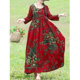 Luźna sukienka maxi w stylu boho z kwiatowym nadrukiem i bocznymi kieszeniami