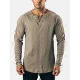 Męska bawełniana koszulka w jednolitym kolorze z okrągłym dekoltem i długim rękawem
