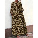 Losvallende damesjurk met luipaardprint en zakken