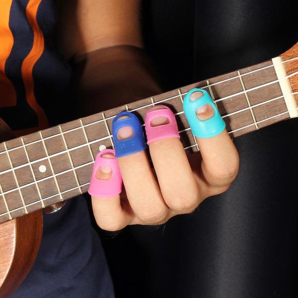 4 in 1 chitarra polpastrello protezioni in silicone dito guardie per ukulele